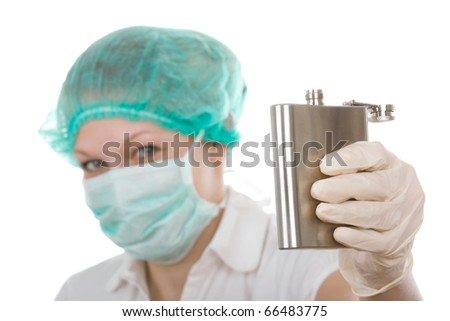 Cheers - doctor with alcohol bottle - focused on bottle - stock photo