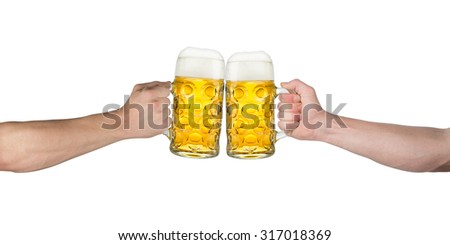 cheers! hands holding up german beer mugs - stock photo