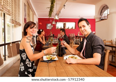 cheers nice appetizer for two in a restaurant - stock photo