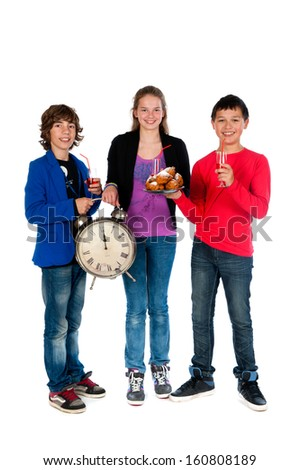 Cheers! on twelve o'clock on new year's eve, three teenagers celebrating New Year - stock photo