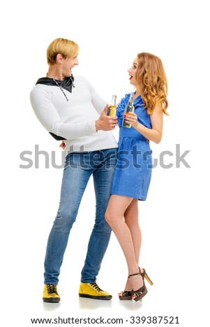 Cheers! Party and relax. Full length of happy smiling couple with bottles of beer having fun together. Isolated on white. - stock photo