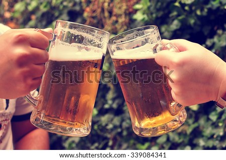 Cheers with beers - stock photo