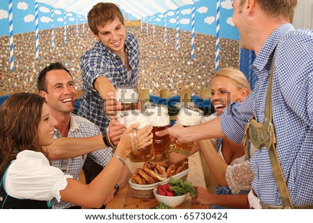 cheers with german beer - stock photo