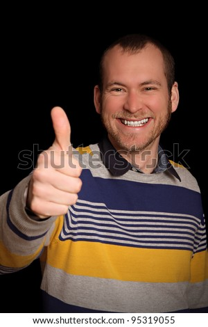 cheery young man in striped sweater likes what he sees - stock photo