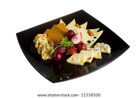 cheese and berry on the black plate