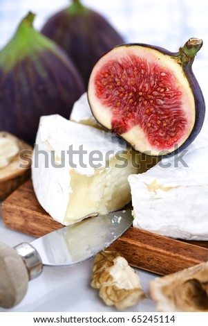 Cheese and figs on a table - stock photo
