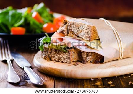 Cheese and ham sandwich of fresh organic bread - stock photo