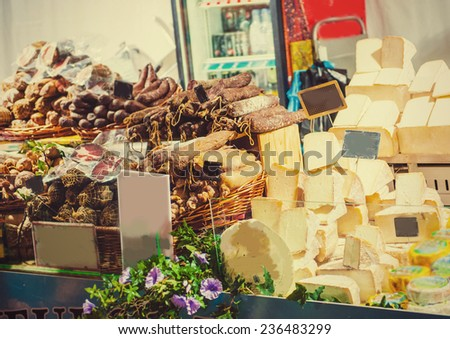 Cheese and meat sausage market in Europe France - stock photo