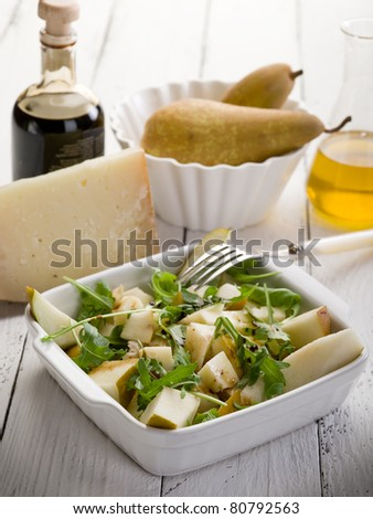 cheese and pears salad with balsamic vinegar and olive oil - stock photo