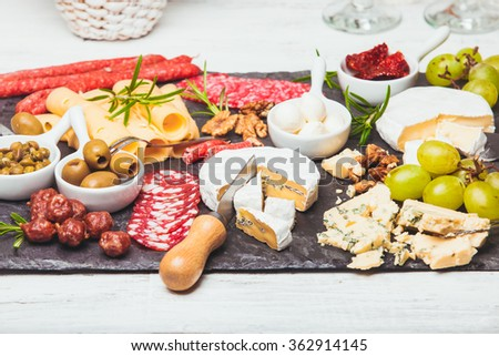 Cheese and salami plate - stock photo