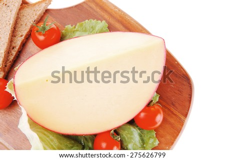 cheese and vegetables served on wooden plate