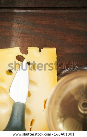cheese and wine on a wooden table