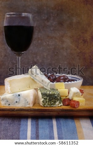 cheese antipasto varieties with olives and wine