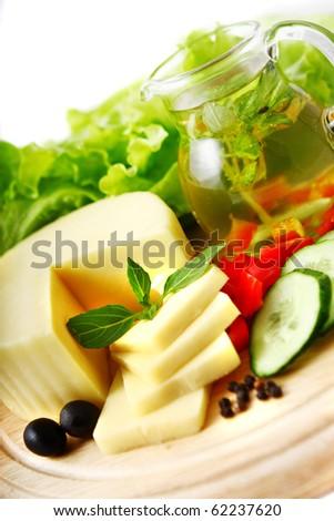 Cheese background. Shallow DOF - stock photo