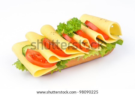 Cheese baguette with tomato, cucumber and salad - stock photo