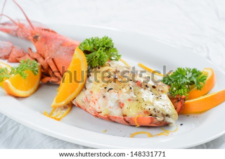 Cheese baked lobster in white plate
