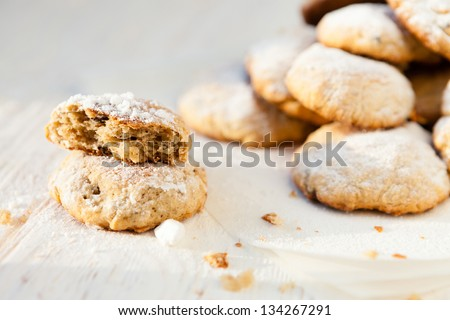 cheese biscuits with icing sugar and chocolate, closeup - stock photo