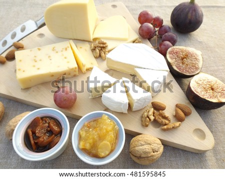 Cheese board, fruits, nuts, pear-lemon jam and carrot-apricot chutney.