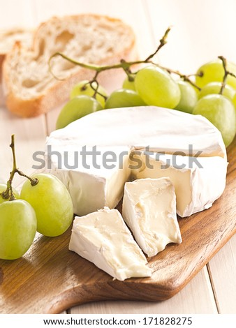 Cheese board with Camembert and grapes