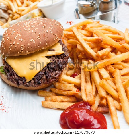 Cheese burger - American cheese burger with fresh salad - stock photo