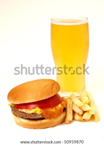cheese burger and fries with golden beer - stock photo