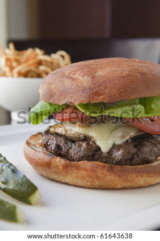 Cheese Burger with French Fries and Pickles - stock photo