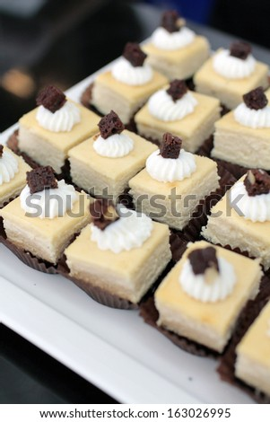 Cheese cake with browny on top serve in party - stock photo