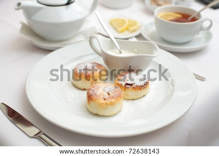 cheese cakes and tea for breakfast - stock photo