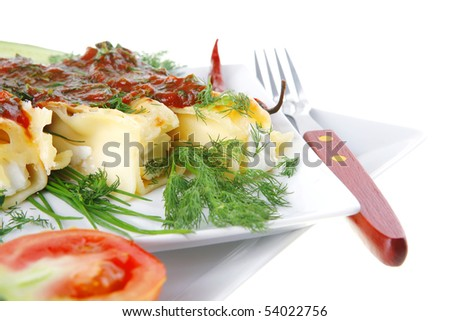 cheese cannelloni served with pepper and tomato on square plate