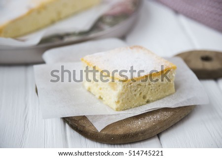 Cheese casserole, sprinkled with powdered sugar