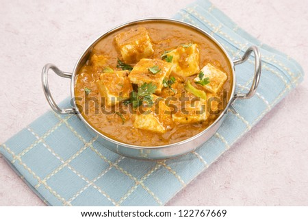 Cheese Cooked in a Creamy Sauce, Indian Dish - stock photo