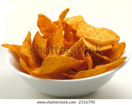 Cheese corn chips, nachos, tortillas, in a white bowl on white. - stock photo