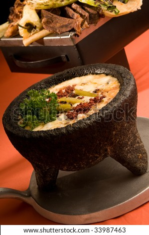 Cheese Fondue on a stone container - stock photo
