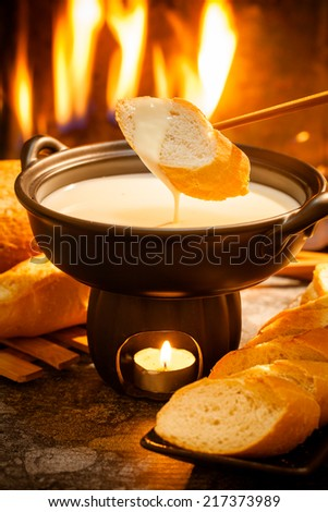 Cheese fondue,Traditional Swiss food for winter - stock photo