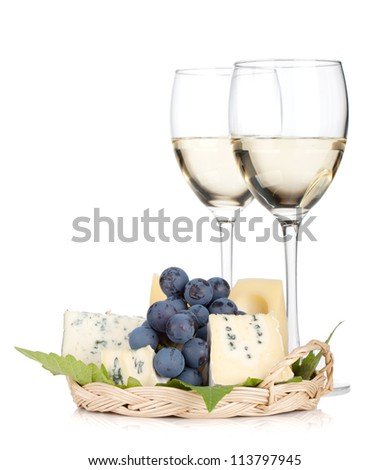 Cheese, grape and two white wine glasses. Isolated on white background - stock photo