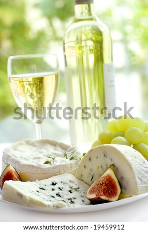 cheese, grape, figs and wine - stock photo