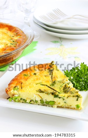 Cheese, herb and pea quiche - stock photo