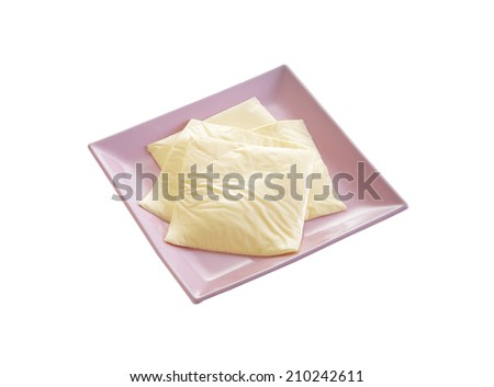 cheese in plastic dish on white background - stock photo