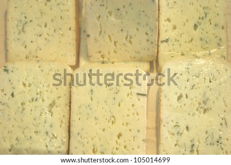 cheese in  plastic wrap - stock photo