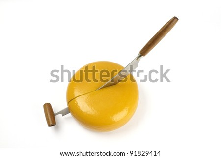 cheese knife is cutting the yellow cheese
