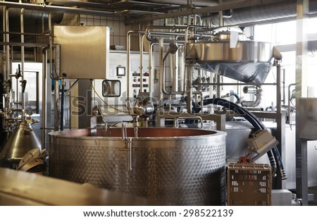 cheese making machine in modern dairy manufactory - stock photo