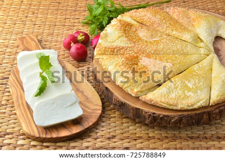 Cheese Manakish - Flatbread topped with cheese. Traditional Arab food - halloumi cheese
