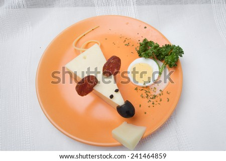 Cheese mouse with sausage and vegetable on the plate - stock photo