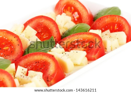 Cheese mozzarella with vegetables in the plate isolated on white