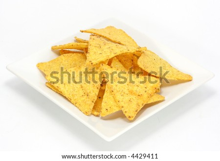 Cheese nachos, chips on the plate on white