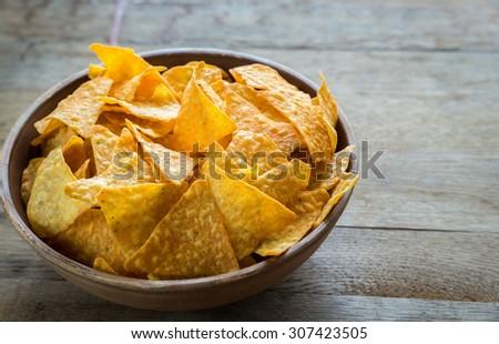 Cheese nachos in the bowl - stock photo