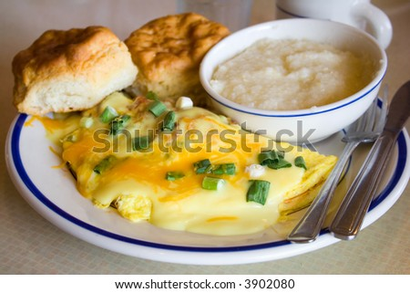Cheese Omelet Breakfast with Onions and Hollandaise Sauce - stock photo