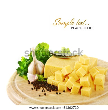 Cheese on a wooden plate with garlic, paprika and herbs. Shallow DOF - stock photo