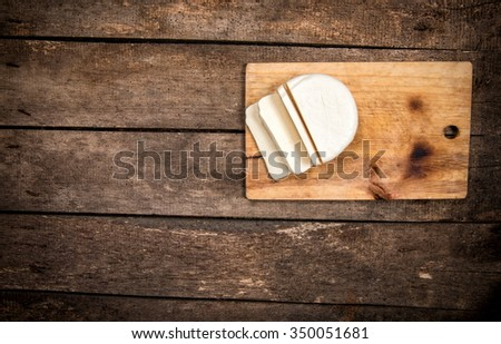 cheese on board, top view - stock photo