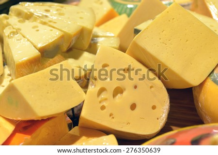 cheese on display in a supermarket - stock photo